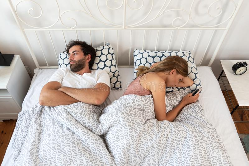 bad-relations-relationship-couple-bed-bored-each-other-124239160